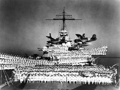 Officers and crew of USS Idaho (BB-42) posed on the aft deck and aft 14-in gun turrets, circa 1938; note SOC-3 Seagull floatplanes of Observation Squadron Three. [740 x 559]✯♫)ڿڰۣ(̆̃̃✞