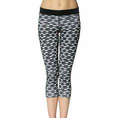 Nike relay Dri-fit printed crop legging tight fold New with tags.  Nike relay Dri-fit crop length black and white leggings. Nike Pants Track Pants & Joggers