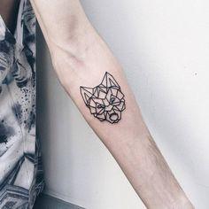 Geometric Wolf Head Tattoo by Severov Roma Tattooer