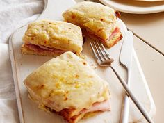 For this classic French sandwich, Ina slathers toasted bread with mustard, adds a slice of ham and sprinkles with Gruyère. She tops her Croque Monsieur with homemade cheese sauce, then bakes until the topping is bubbly and lightly browned.