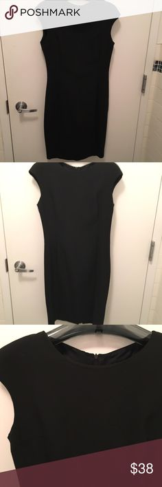 "Zara - Perfect Little Black Dress - Large Worn twice - in perfect condition except there is a small place along the seam under the zipper in the back that needs to be stitched up (really easy and minor for anyone with a needle and thread - see photo). This classic dress is extremely flattering and is the perfect LBD. Dress is fully lined and does't have very much stretch. Small built-in shoulder pads add to the classic look. About 38.5"" from shoulder to hem. Outer Shell: 48% polyester, 48%…"