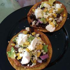 Vegetarian tostado:  -Refried beans -Black beans -Purple Onion chopped -Corn -Avocado  -Feta Cheese -Light Sour cream  Remember buy organic and non-GMO