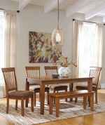 The rich country style of the Berringer dining room collection reflects back to the days when beautifully crafted furniture was made by hand to enhance the look of your home.