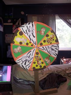 Spin to Win Game.. Created three flags (animals on the wheel) for each person to use to play. Then they would pick which one they want the wheel to land on. Then you keep playing till you have the desire amount of winners.