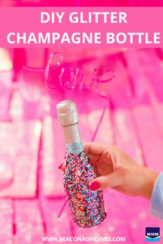 Add glitz and glamour to your champagne bottle with this super chic DIY! Using Beacon's Felt Glue, you can add glitter to your champagne bottle... this will certainly be fun to pop on NYE! #MadeWithBeacon Glitter Champagne Bottles, Felt Glue, Nye, Adhesive, Banner, Glamour, Ring, Chic, Projects