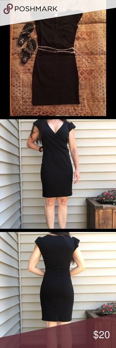 Venus black faux wrap jersey dress This classic little black dress is a size extra small but will fit a size small. Flattering left side ruching at the waist and cap sleeves. V neck line Criss  cross front. 80% cotton and 20% spandex. This dress can be dressed up with heels or dresses down with sandals. it is very versatile. Venus Dresses