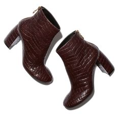 These towering ankle boots are made from highly polished, croc-embossed faux-leather—in a gorgeously subtle shade of burgundy, which works beautifully as a fall