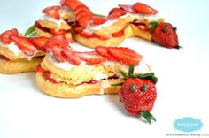 Strawberry Snake Shaped Eclairs. By SweetAsHoneyNZ.
