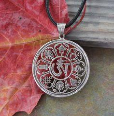 Dharmashop.com - Handmade Cutout Sterling Silver Om 8 Auspicious Pendant , $108.00 (http://www.dharmashop.com/handmade-cutout-sterling-silver-om-8-auspicious-pendant/)