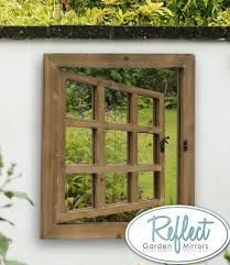 x Window Effect Glass Garden Illusion Mirror This mirror adds space and light to your garden spaces with all the subtlety and grace of a master magician. The carefully shaped frame is designed to trick the eye into seeing depth which isn't there. Garden Mirrors, Garden Windows, Small Space Gardening, Garden Spaces, Mirror Illusion, Wooden Shutters, Window Shutters, Thing 1, Window Mirror
