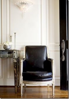 living room paneling | black leather chair