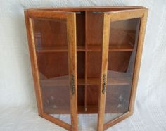 Vintage wooden wood wall display cabinet apothecary spice rack medicine chest shot glass display two door doors glass front wall cabinet