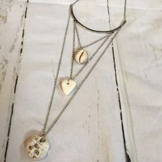 I just discovered this while shopping on Poshmark: Three tier bar necklace. Check it out! Price: $30 Size: OS