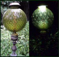 Vintage lamp globe on metal rod and lamp parts. Solar light in what would normally be the bottom of the globe.