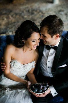 Beautiful couple photograph!  Nikki Meyer Photography http://www.confettidaydreams.com/classic-elegant-gold-black-white-wedding/