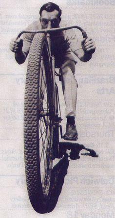 Buster Keaton rides a bike.
