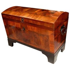 A Boldly-Scaled German Biedermeier Walnut Domed Trunk with Parquetry Reserves | From a unique collection of antique and modern trunks and luggage at http://www.1stdibs.com/furniture/more-furniture-collectibles/trunks-luggage/