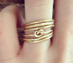 Six Textured Brass and Infinity Knot Stacking Rings on Etsy