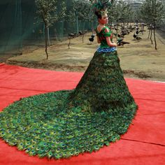 But where would I wear a formal gown with a huge peacock train?  *giggles*