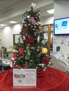 mitten tree. hats, mittens and scarves can be donated to those in ...