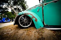 Awesome photographer... www.vdubprints.com. Love the clean rims on the patina'd car.