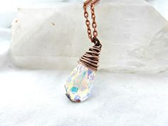 Swarovski crystal AB teardrop pendant and copper necklace. Copper wire wrapping. https://www.andriabieberdesigns.com/