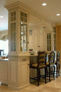 LOVE. THIS!!! Arch in between instead of overhead cabinets. Replace column with the glass cabinet?
