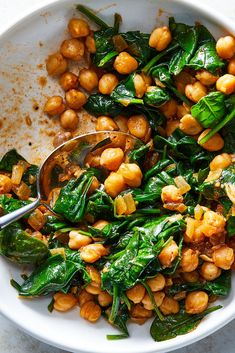 Chickpeas with Spinach: NYT Cooking: This is mostly a pantry dish, very quick to put together. You can serve it on its own, with couscous or pasta, or over a thick slice of toasted bread rubbed with garlic. Chickpea Recipes, Vegetable Recipes, Spinach Recipes Vegetarian, Spinach Dinner Recipes, Kale Recipes, Veggie Dishes, Food Dishes, Clean Eating, Healthy Eating