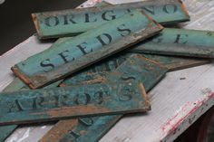 Make vintage looking wooden garden signs. 1. Cut the plywood. 2. Paint it. 3. Stencil it with a different color. 4. Let it dry then rough it up with sandpaper and a paint scraper.