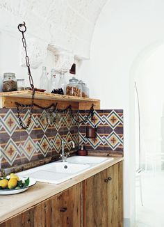 Gorgeous Moroccan inspired tiles in this rustic and exotic style kitchen.