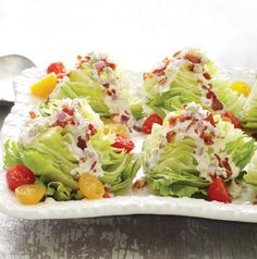 Wedge salads are back! Gotta love it. Mini Wedge Salads are topped with homemade blue cheese dressing, bacon and tomatoes. Love it.