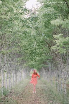 senior picture ideas for girls. coral dress, green garden, beautiful location. Myrtle Beach High School Senior Portrait Photography by Pasha Belman