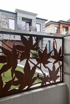 Laser cut 'Maple' fence infills (with 'Maple' balustrade feature panes in the background). Designed & constructed by Entanglements metal art