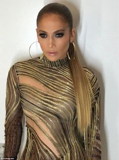 As JLo twirled around to show off her sexy cut-out dress, the former pro baseball star jokingly bumped into her accidentally on purpose as he carried a couple of plastic bottles of water.