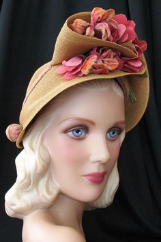 A draped hat from the 1940s, with a corseted back    I could make this with a plain and floppy straw hat I'm very tired of...