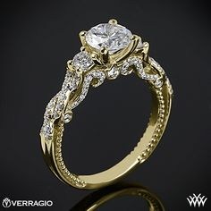 This 3 Stone Engagement Ring is from the Verragio Insignia Collection. It features Round Brilliant Cut Diamond Melee that enhance a center diamond of your choice. For Center Diamonds between 2.00 and 3.00 carats, add $300.