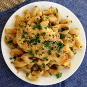 A rich lemon-caper sauce made with extra-virgin olive oil and butter flavors this chicken piccata with pasta.