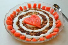 Oatmeal topped with watermelon.