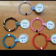 Choose 5 Lokai Bracelets Choose any 5 Lokai Bracelets from the colors: red, pink, blue, clear, and camo. Sizes available are: Small, medium, large, XL. Fast shipping! Simply comment which you would like before purchasing. Thanks :) 100% authentic Lokai Jewelry Bracelets