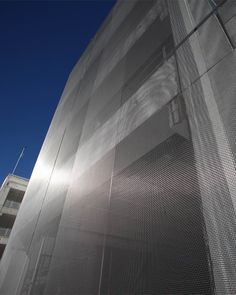 Stainless steel wire mesh facade cladding at car park Exhibition Bologna. Haver Architectural Mesh.