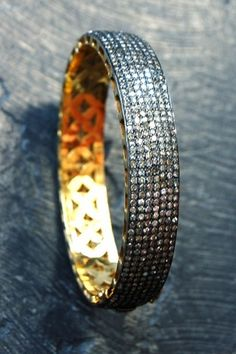 RONA PFEIFFER   Oval pave Diamond Bangle* Pave Diamond Oval Bangle set in Sterling Silver .925 and 14K Gold backing 5,550. USD
