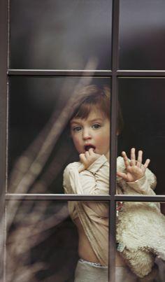 Behind the window.