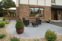 Canterra flags in Silver (with Cashel setts, Bullnose Kerb Setts step riser in Slate Non-rumbled and Caliza flags tread in Sandstone Ground)
