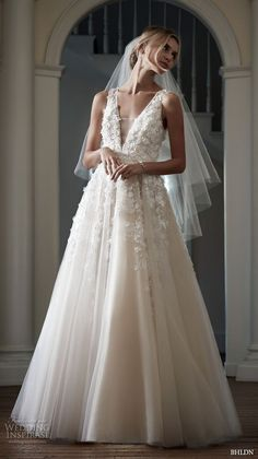 BHLDN Spring 2016 #bridal gowns stunning romantic a line ball gown wedding dress flora applique v plunging neckline style / http://www.deerpearlflowers.com/deep-plunging-v-neck-wedding-dresses/2/