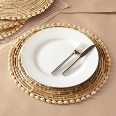 Shop Two's Company  3548 Pandan and Seashell Placemats (Set of 4) at ATG Stores. Browse our placemats, all with free shipping and best price guaranteed.