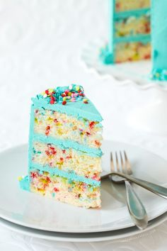 Fun and colorful funfetti cake made from scratch (without cake mix) with whipped vanilla bean buttercream.