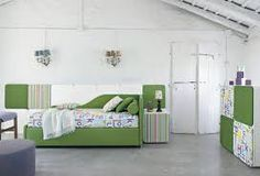 Twils has more than 20 years' experience in upholstered beds, accessories and bed linen and has always been passionate about design and trends. Lit Simple, Textiles, Upholstered Beds, Sofa Bed, Decoration, Linen Bedding, Sofas, Toddler Bed, Fabric