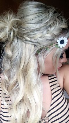 Music festival hair style braid half up bun flower blonde