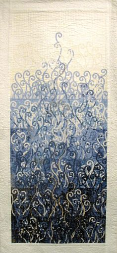 "Blue Tranquility art quilt by Lonni Rossi. 27 w x 58.5"" L. Constructed from Lonni's commercially printed cotton fabrics; heavily machine embroidered and quilted."