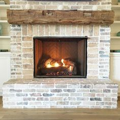 Image result for brick fireplaces with wood mantels